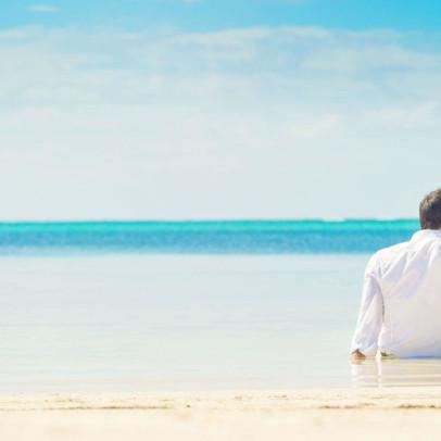 Couple-on-Las-Terrazas-Resort-s-private-beach_interior_masthead